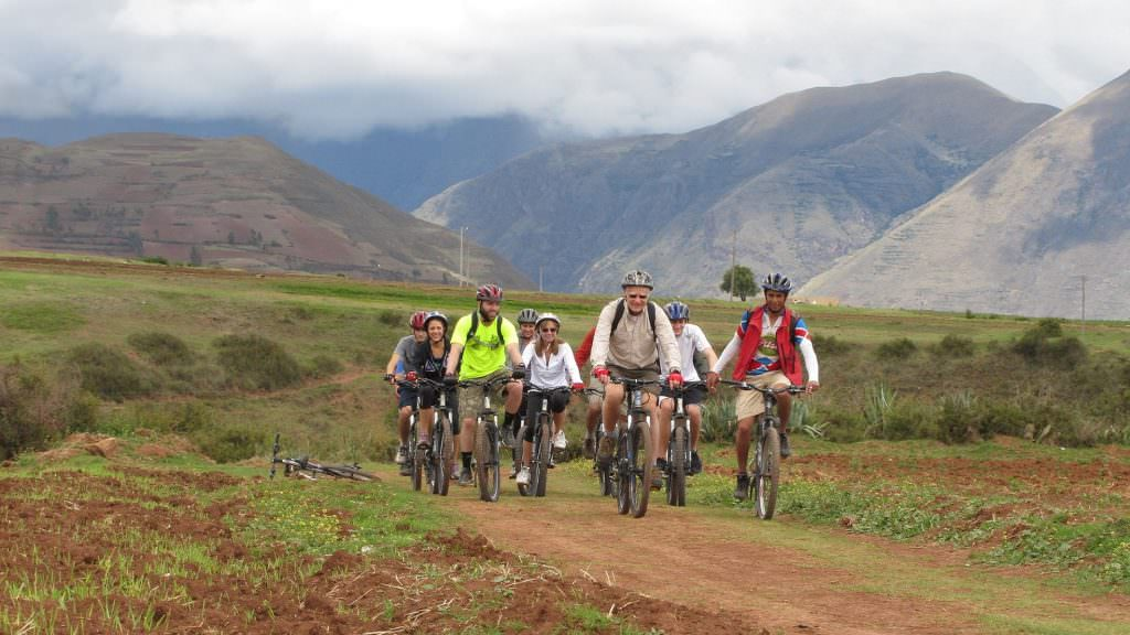 FEATURED BIKING TO MORAY MARAS SALT MINES FD 1024x576 - Tour Full-day Rainbow Mountain Vinicunca and Red Valley Cusco